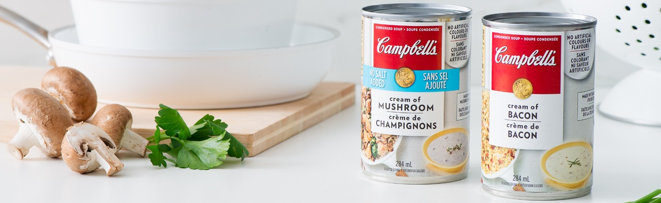 Campbell's Condensed soup cans beside cooking equipment