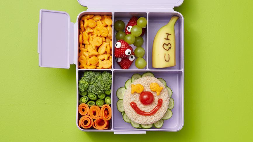 All Smiles Bento Box on green Background