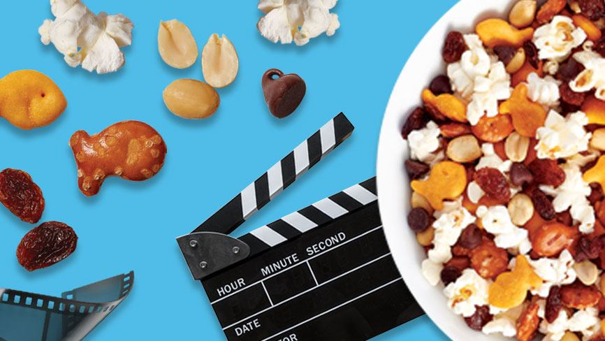Goldfish® Best Movie Night Mix in a bowl with film strip and film clapboard on blue background