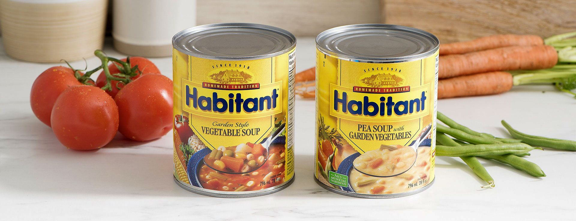 Habitant soup cans with tomatoes, pea shoots and carrots